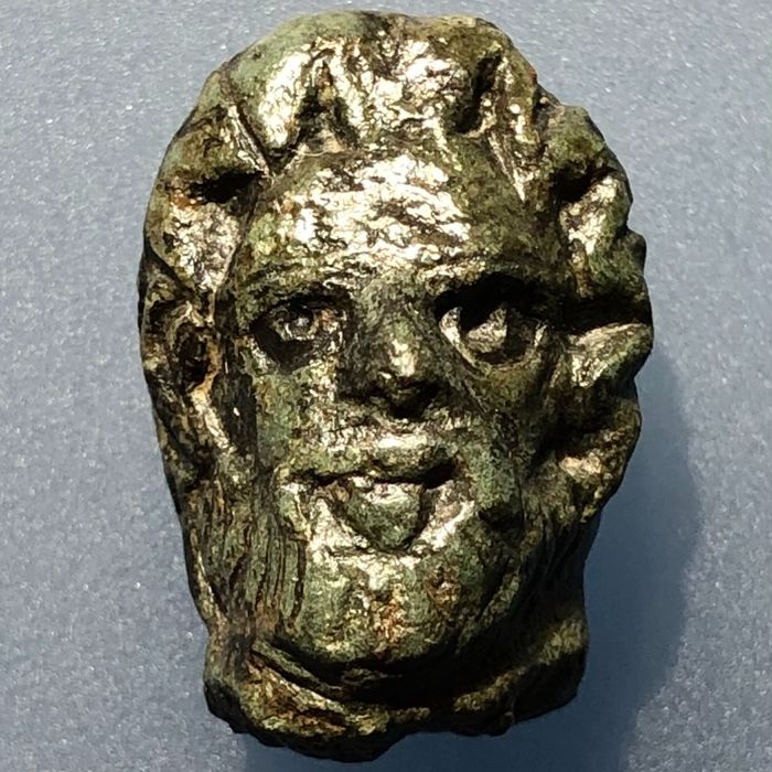 Ancient Roman Bronze Head with a Portrait of the Supreme God Jupiter (Zeus) in very Figurative and finely detailed Style.