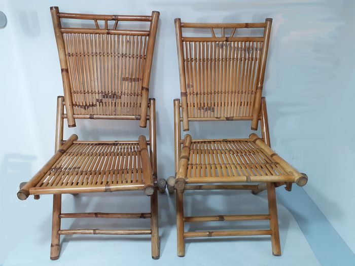 Two bamboo folding chairs.