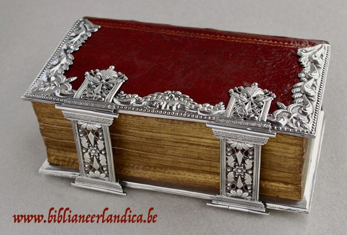 Bible - Bound in red morocco with broad silver mounts and clasps - 1770
