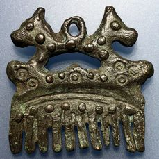 Viking Bronze Exceptional and Extremely Rare Zoomorphic Comb Surmounted with Two Lynx Decorated with Solar Symbols