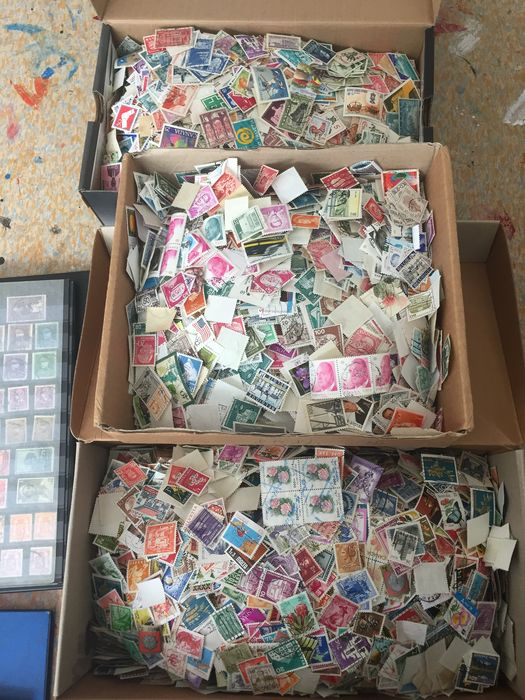 Welt - Lot of about 50,000 stamps world in stock books + loose in boxes