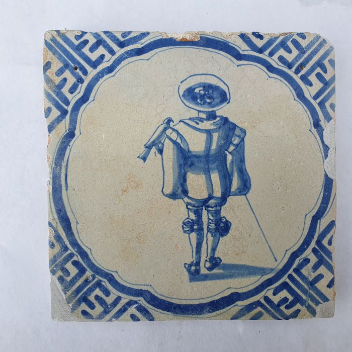 Antique tile with falconer in meander (1) - Earthenware
