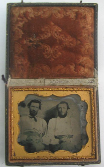 . Fine quality ambrotype framed in full leather case features two men posing for the camera.19th cent.