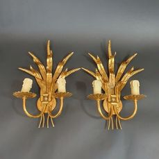 A pair of Hollywood Regency style wall lights