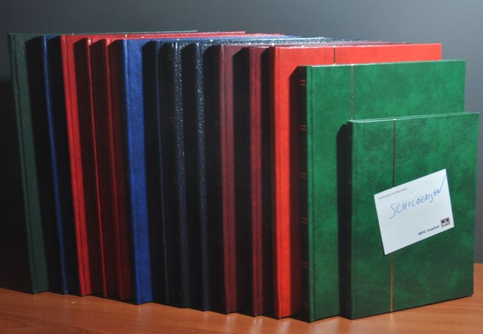 Weltthema - Batch in a stack of stock books with various topics