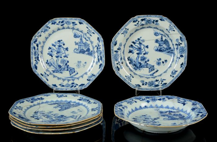 A service of seven Chinese octagonal plates (7) - Blue and white - Porcelain - Pagoda, swastika fence, trees, islands, dwellings - China - 18th century