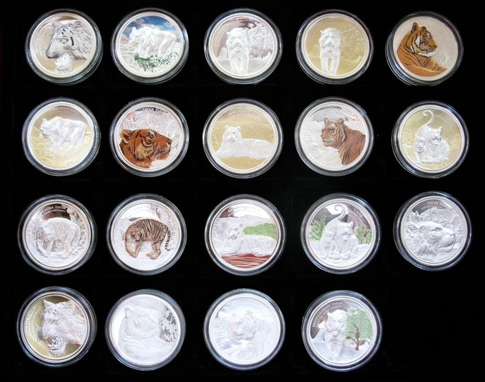 """World. Medals, 50 Years conservation of Endangered Wildlife """"Tigers""""  (19 different pieces) silver plated in collectors box"""