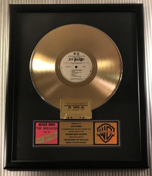 """Sex Pistols - """"Never Mind The Bollocks. Here's The Sex Pistols"""" LP, Cassette Gold Record Award Presented To Jones - Officieel in-House award - 1989/1989"""