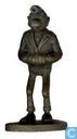 Lucien dans les poches in bronze