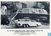 Lady Penelope's FAB 1 rolls royce outside the round house on Tracy Island.