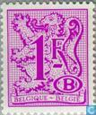 Digit on heraldic lion with B in an oval and streamer