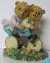 tricycle with two bears on it