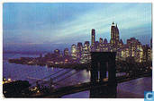 Nightfall in Lower Manhattan, with Brooklyn Bridge, New York City